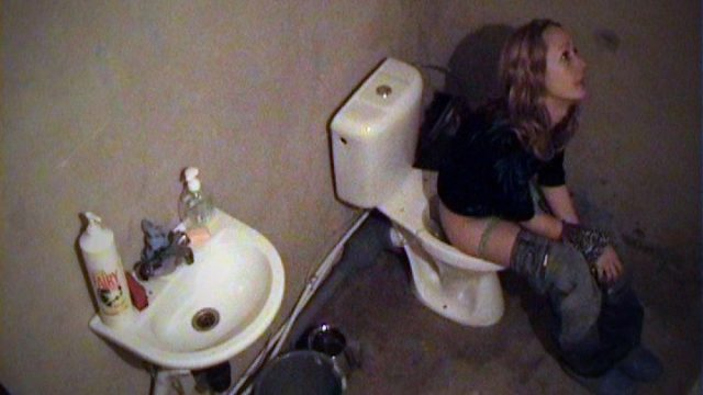Lovely chick pissing in the lavatory!